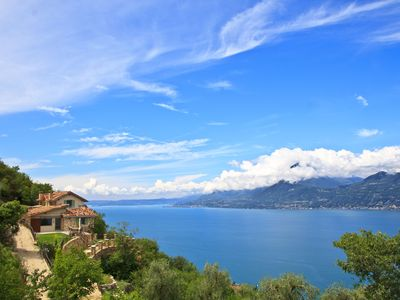 Photo for New luxury villa on quiet hillside with stunning views and romantic Olive Grove