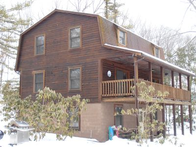Six Bedroom Lakefront Log Home With A Dock Slip On Deep Creek Lake.