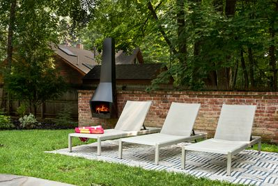 Stretch out on the reclining lounges next to the pool +  outdoor fireplace