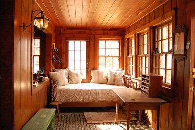 Sunroom (day bed may be used for sleeping, open to the living room)