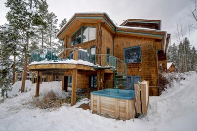 Older photo (before new siding) showing the hot tub area in SKI SEASON.