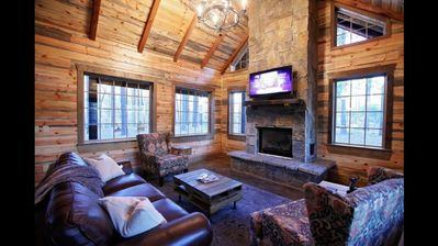 """Indoor Gas Fireplace with 55"""" HDTV and spacious living room with pull out couch"""