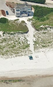 Aerial view of the 1.1 acre beachfront property featuring a large private beach.