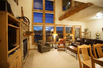 Spacious Living Area with Mountains Framed by Huge Windows