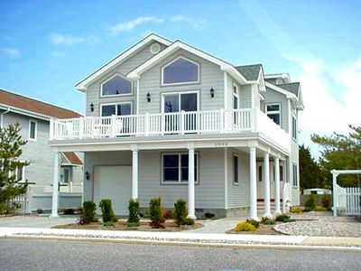 Photo for This immaculate beach block beauty is located on the east side of First Ave