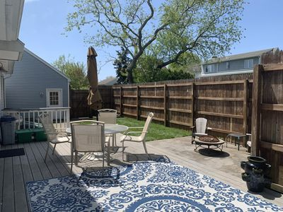 Large private back deck with hot tub, fire pit, 2 patio tables, plenty of chairs