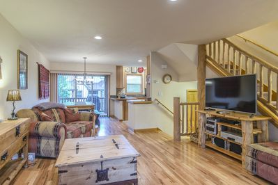Living Area- - Living Area- Located upstairs with hardwood floors, natural lighting, and a flat screen TV.