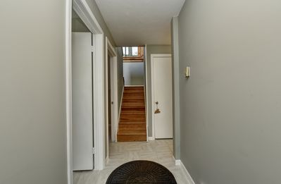 Entryway. Three bedrooms are on this floor with the main living area upstairs.