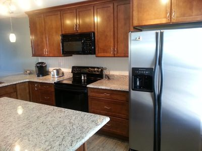 Upgraded appliances with granite countertops.