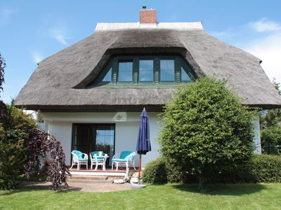 Photo for Thatched cottage with garden near the beach in a quiet location