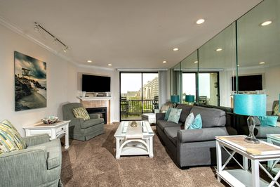 The ocean view living area has been beautifully refurbished in soothing colors of the ocean.