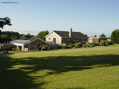 House set in 2 acres of lawns and stone patio