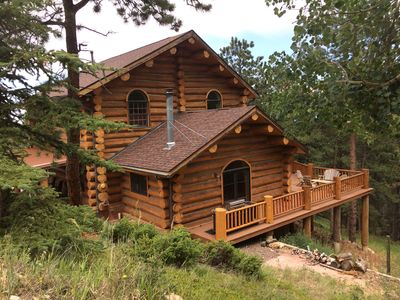 Photo for Spacious and secluded log cabin with deck in the mountains