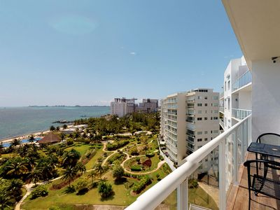 Photo for Waterfront getaway w/ beach access, shared infinity pool, garden, & picnic area