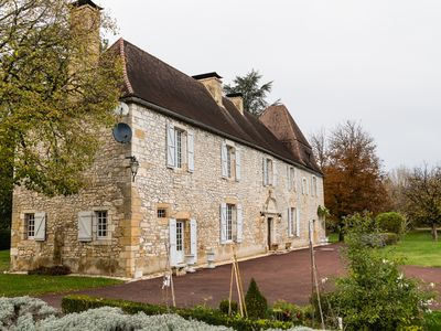Photo for Stunning manor with private heated pool and tennis court on the Dordogne river