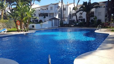 Photo for The President 3 bed GF apartment with private garden near the pool