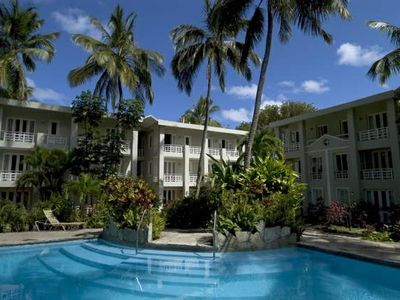 Unique, pool,  private gardens, walking distance to beach, shops.
