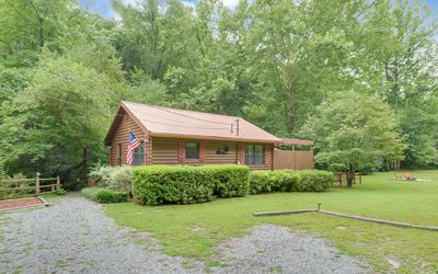 Photo for Tranquil, creekfront w/flat land, hot tub, fenced yard, pet friendly