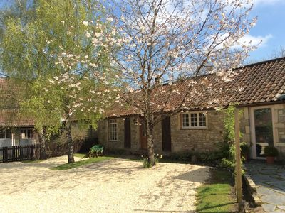 Photo for Dog friendly Cotswold cottage with large private garden. Near Bristol and Bath.
