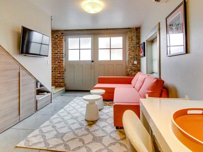 Photo for Modern downtown loft w/ beautiful exposed brick & amazing location!