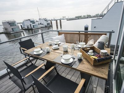 Photo for Exclusive floating house - holiday on the Baltic Sea surrounded by water with a sandy beach within walking distance - phenomenal roof terrace - private mooring - sauna