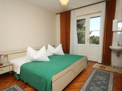 Photo for Three bedroom apartment with balcony and sea view Makarska (A-6717-a)