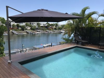 Photo for Luxury 5 Bedroom Waterfront Home - 10mins to themeparks & Comm Games transport
