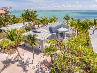 Photo for LUXURIOUS BEACHFRONT HOME, FISHING DOCK, SHELLING, PRIVATE BEACH, 2 GOLF CARTS