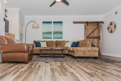 Custom Barn Door and Large Sectional to relax