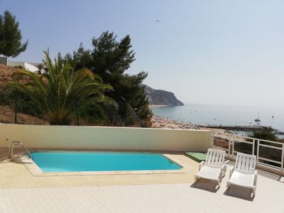 Photo for Beachfront apartment with private pool in Sesimbra