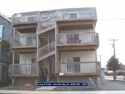 Photo for Ocean Views.!!!!!  Beachblock condo. Central A/C and both front and rear decks. Only steps to the beach and promenade.