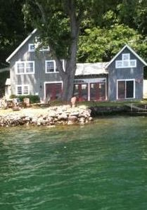 O'Cottage! 150 feet of level lake frontage. Located on a private, one-lane road.