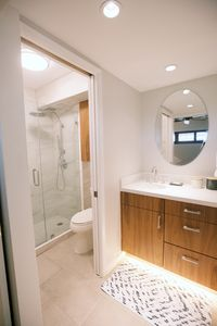 Floating vanity with under cabinet lighting.