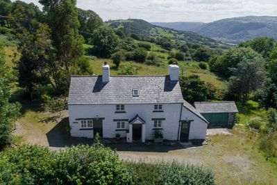 Bryn Rhydd is a traditional stone cottage in an elevated position of the Bodnant Estate
