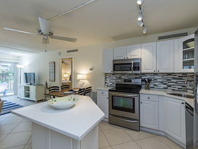 Photo for Two blocks to beach and three to Fifth Ave. Large patio and beautiful courtyard.