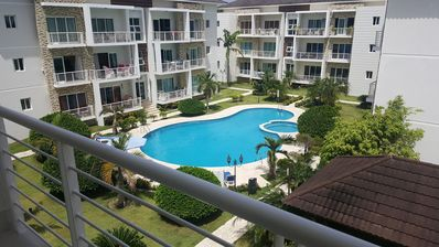 Photo for Top-floor quiet condo with large pool and garden near everything, BBQ/WiFI/TV