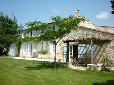 Photo for Charente house charm with private pool 25km from the sea