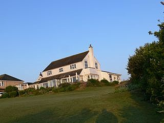 Photo for Secluded Ground floor Apartment With Sea Views On Golf Course.