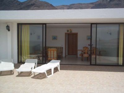 Photo for Bungalow TOFYZI in Famara for 4 persons with terrace, garden, views to the ocean, views of the volcanoes, WIFI on the go and less than 500m to the sea