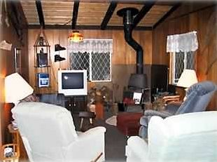 Living room with woodstove.