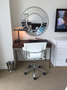 Desk with with built-in electric outlet. The mirror can double as makeup station