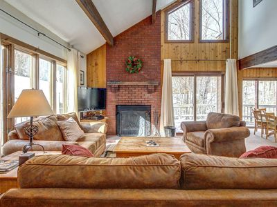 Photo for Spacious home w/ large deck, hot tub, movie room & sauna!