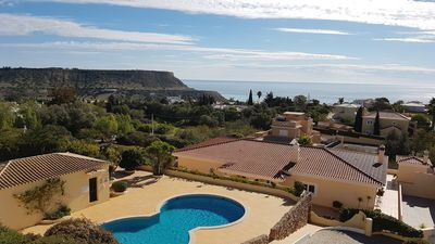 Photo for Apartment with stunning sea views, private sun terrace and shared pool.