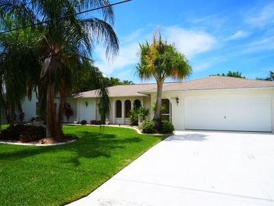 Photo for Happy Days - SE Cape Coral, 3b/2ba Pool Home, Gulf Access, Solar heated Pool, Boat Dock w.Lift,