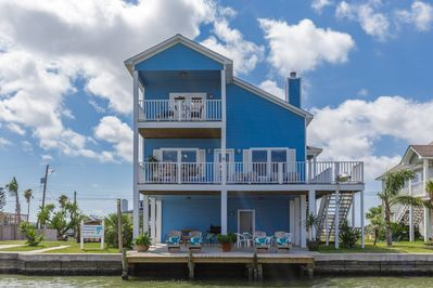 Two balconies with fantastic water views. Large covered downstairs area w/dock.