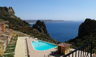Photo for Cottage style apartment in Villaggio Tanca Piras, Iglesias, pool, sea view.