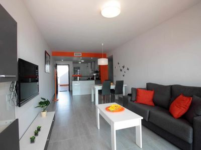 Photo for Naranja, apartment with garden in luxury residence on the beach