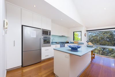 2.The kitchen is very well equipped with stunning 180 degree water views