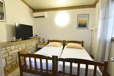 Bedroom with TV and air conditioner