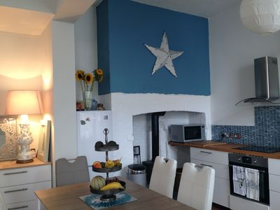 Open plan ground floor with kitchen/diner and living room, under vaulted ceiling